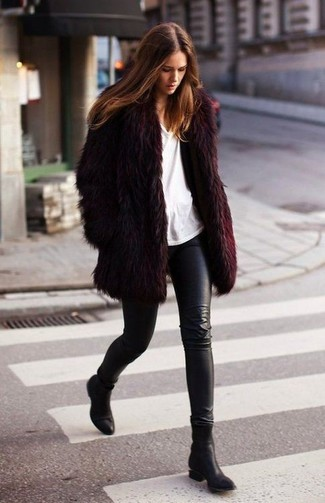 How to wear: black leather ankle boots, black leather leggings, white crew-neck t-shirt, burgundy fur coat
