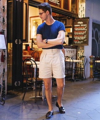 How to wear: navy leather watch, black leather loafers, beige linen shorts, navy crew-neck t-shirt