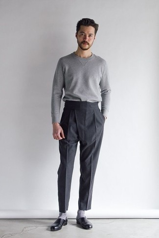 Men's Looks & Outfits: What To Wear In 2020: You'll be surprised at how extremely easy it is to pull together this sophisticated look. Just a grey crew-neck sweater matched with black dress pants. Consider a pair of black leather loafers as the glue that brings your look together.