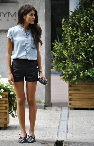 How to wear: black studded leather clutch, black studded suede loafers, black leather shorts, light blue short sleeve button down shirt