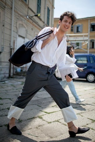 Men's Looks & Outfits: What To Wear In 2020: Reach for a white long sleeve shirt and charcoal chinos for knockout menswear style. And it's amazing what a pair of black woven leather loafers can do for the look.