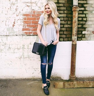 How to wear: black quilted leather crossbody bag, black leather loafers, navy ripped skinny jeans, grey v-neck t-shirt
