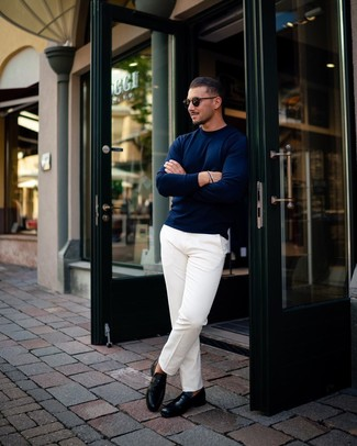 How to wear: black sunglasses, black leather loafers, white chinos, navy crew-neck sweater