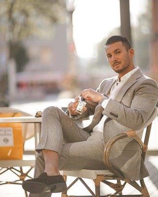 How to wear: silver watch, black suede loafers, white dress shirt, grey wool suit
