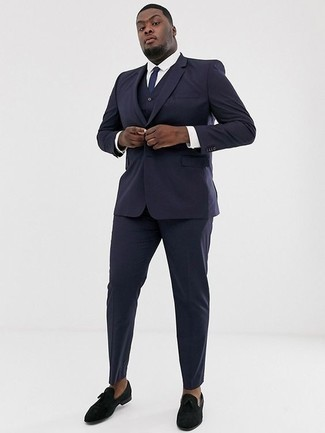 How to Wear a Navy Three Piece Suit: For manly refinement with a fashionable spin, you can easily opt for a navy three piece suit and a white dress shirt. A pair of black velvet loafers will add a mellow vibe to this getup.
