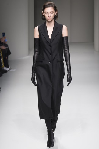 How to wear: black tights, black leather long gloves, black velvet ankle boots, black tuxedo dress