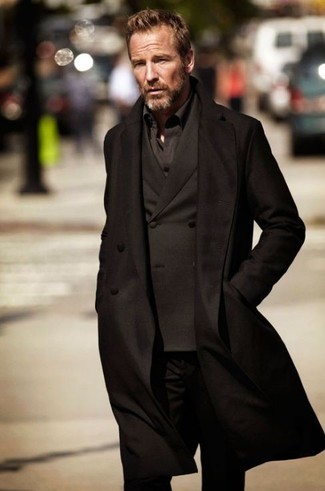 How to wear: black jeans, black long sleeve shirt, black double breasted blazer, black overcoat
