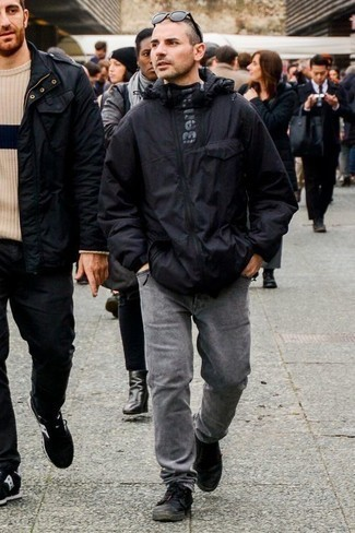 How to Wear Black Canvas Low Top Sneakers For Men: Rock a black windbreaker with grey jeans to feel confident and look casual and cool. If you're on the fence about how to finish, a pair of black canvas low top sneakers is a goofproof option.