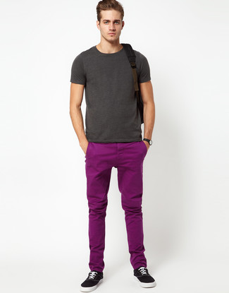 How to Wear Purple Chinos In Hot Weather: For an outfit that provides comfort and fashion, try pairing a charcoal crew-neck t-shirt with purple chinos. Black canvas low top sneakers tie the outfit together.