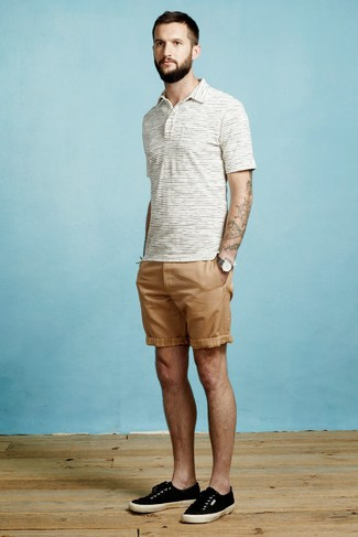 How to wear: charcoal canvas watch, black canvas low top sneakers, tan shorts, white horizontal striped polo