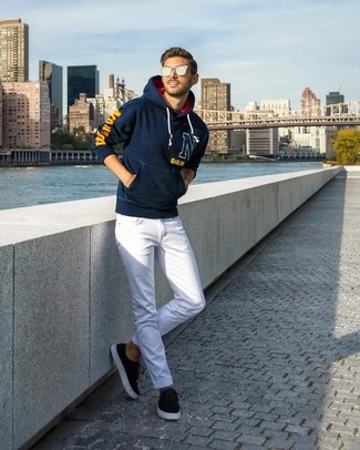 How to wear: silver sunglasses, black suede low top sneakers, white jeans, navy print hoodie