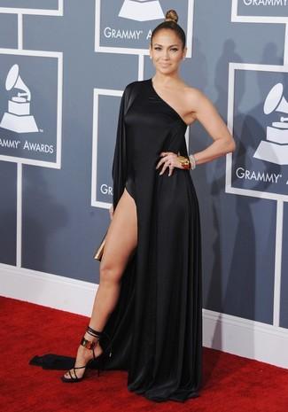 Jennifer Lopez wearing Black Slit Maxi Dress, Black and Gold Leather Heeled Sandals, Gold Clutch, Gold Bracelet