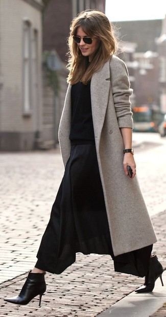How to wear: black leather ankle boots, black pleated maxi skirt, black crew-neck sweater, grey coat