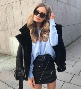 How to wear: black sunglasses, black leather mini skirt, light blue oversized sweater, black shearling jacket