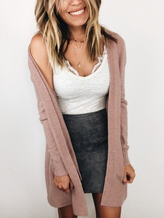 How to wear: gold pendant, black leather mini skirt, white tank, pink long cardigan