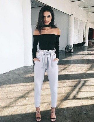 For those who like the comfort look, wear an Anna Field Long Sleeved Top Black and grey tapered pants. Black suede heeled sandals will add elegance to an otherwise simple look. What an exciting option for hot weather!