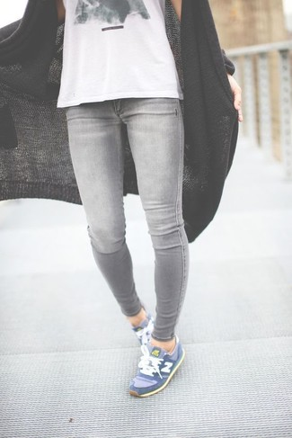 How to wear: black knit open cardigan, white and black print tank, grey skinny jeans, blue athletic shoes