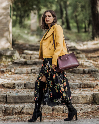 How to wear: burgundy leather tote bag, black suede over the knee boots, black floral maxi dress, yellow biker jacket