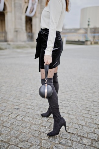 How to wear: black leather clutch, black suede over the knee boots, black velvet mini skirt, white turtleneck