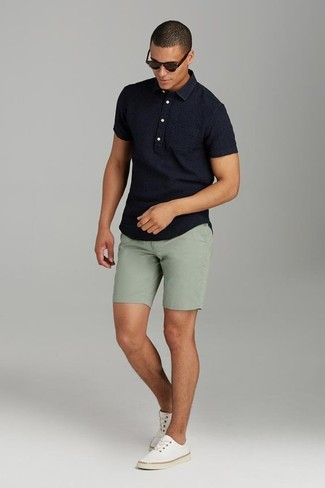 How to wear: black polo, olive shorts, beige canvas low top sneakers, dark brown sunglasses