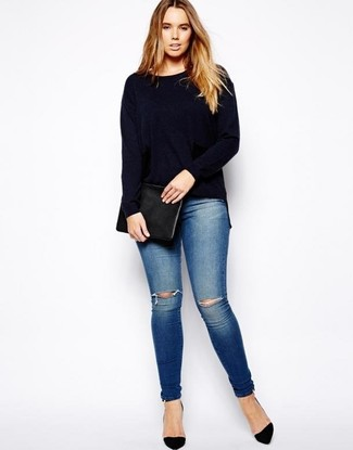 How to wear: black leather clutch, black suede pumps, blue ripped skinny jeans, navy crew-neck sweater