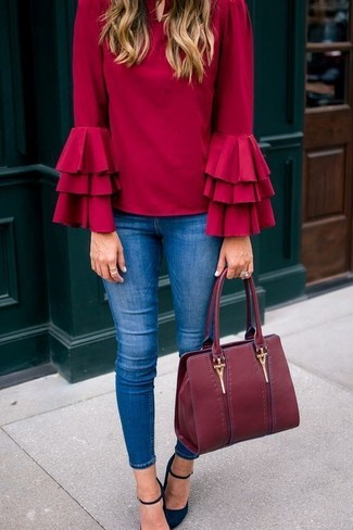 How to wear: burgundy leather tote bag, black suede pumps, blue skinny jeans, red ruffle long sleeve blouse