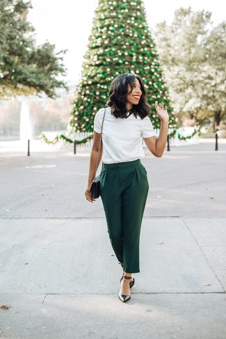 How to wear: black quilted leather crossbody bag, black leather pumps, dark green tapered pants, white crew-neck t-shirt