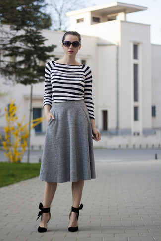 How to wear: black sunglasses, black suede pumps, grey pleated midi skirt, white and black horizontal striped long sleeve t-shirt