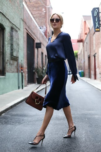 How to wear: burgundy leather satchel bag, black leather pumps, navy velvet midi skirt, navy satin long sleeve blouse
