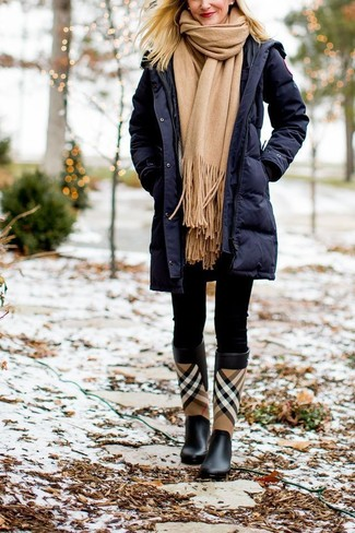 How to wear: tan scarf, black plaid rain boots, black leggings, navy puffer coat