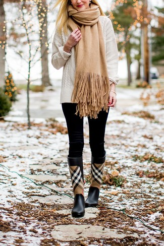 How to wear: tan scarf, black plaid rain boots, black leggings, white cable sweater
