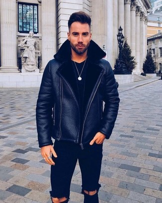 How to wear: black ripped skinny jeans, black crew-neck t-shirt, black shearling jacket