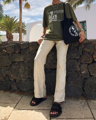 How to Wear Beige Linen Chinos: If you prefer classic combos, then you'll appreciate this combo of an olive print crew-neck t-shirt and beige linen chinos. Up the appeal of your look by slipping into a pair of black canvas sandals.