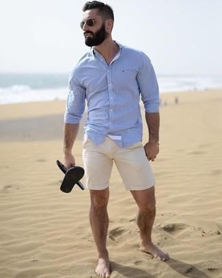 How to wear: black sunglasses, black rubber sandals, beige shorts, light blue dress shirt