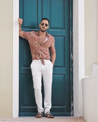 How to wear: black sunglasses, black leather sandals, white chinos, pink floral short sleeve shirt