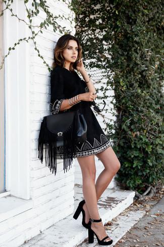 How to wear: silver bracelet, black fringe leather satchel bag, black suede heeled sandals, black embroidered peasant dress