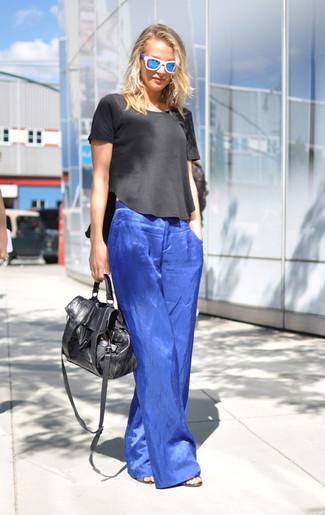 How to wear: blue sunglasses, black leather satchel bag, blue wide leg pants, black short sleeve blouse