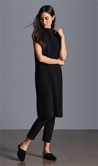 How to Wear a Black Sweater Dress: This laid-back pairing of a black sweater dress and black skinny pants is a fail-safe option when you need to look chic in a flash. Why not complement this outfit with black satin mules for an added dose of class?