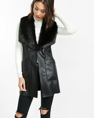 How to wear: black shearling vest, white turtleneck, black ripped skinny jeans