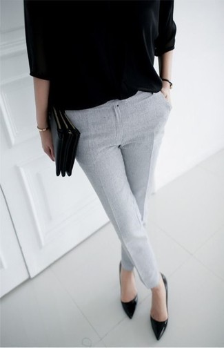 How to wear: black short sleeve sweater, grey skinny pants, black leather pumps, black leather clutch