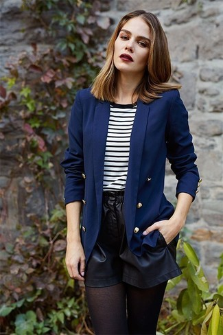 How to wear: black tights, black leather shorts, white and black horizontal striped crew-neck t-shirt, navy double breasted blazer