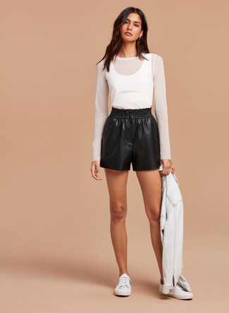 How to Wear Black Leather Shorts For Women: For a cool and relaxed ensemble, go for a white denim jacket and black leather shorts — these pieces fit really good together. Complement this look with a pair of white low top sneakers for maximum impact.