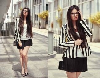 How to wear: black quilted leather crossbody bag, black shorts, white tank, black and white vertical striped blazer