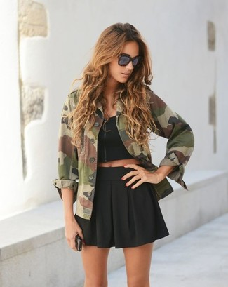 How to wear: dark brown leopard sunglasses, black skater skirt, black cropped top, olive camouflage military jacket