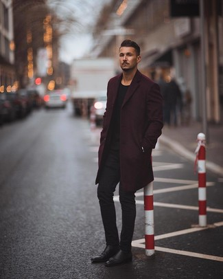 How to wear: black leather chelsea boots, black skinny jeans, black crew-neck sweater, dark purple overcoat