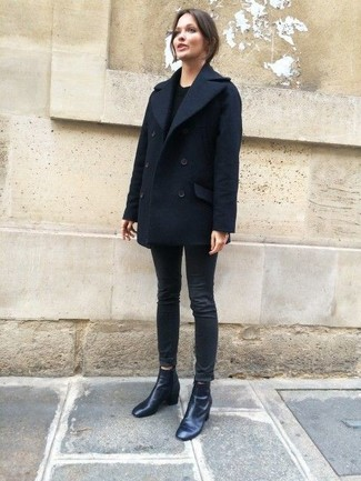 How to wear: black leather ankle boots, black skinny jeans, black crew-neck sweater, navy pea coat