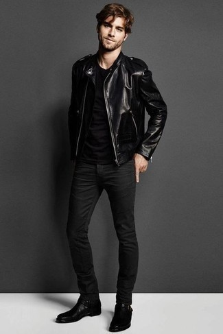 Men's Looks & Outfits: What To Wear In 2020: This combo of a black leather biker jacket and black skinny jeans is hard proof that a safe casual ensemble can still be really interesting. You can follow a classier route on the shoe front with a pair of black leather chelsea boots.