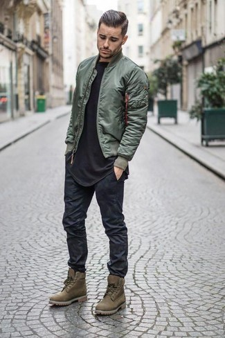 How to wear: olive suede work boots, black skinny jeans, black crew-neck t-shirt, olive bomber jacket