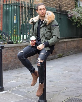 How to wear: tan suede chelsea boots, black ripped skinny jeans, black crew-neck t-shirt, olive puffer jacket