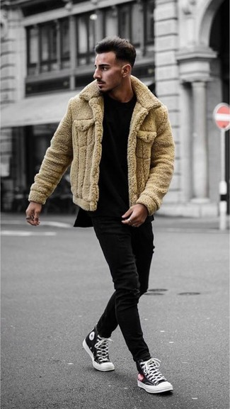 How to wear: black and white canvas high top sneakers, black skinny jeans, black crew-neck t-shirt, tan shearling jacket